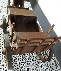 Fabulous antique Paper mache horse on wheels with rare wooden carriole